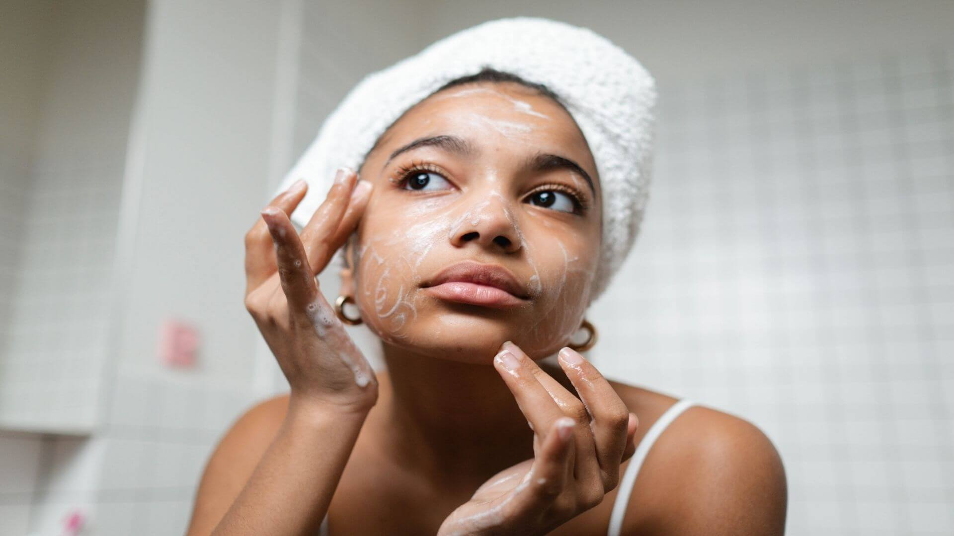 flushing your face with hydrating face wash